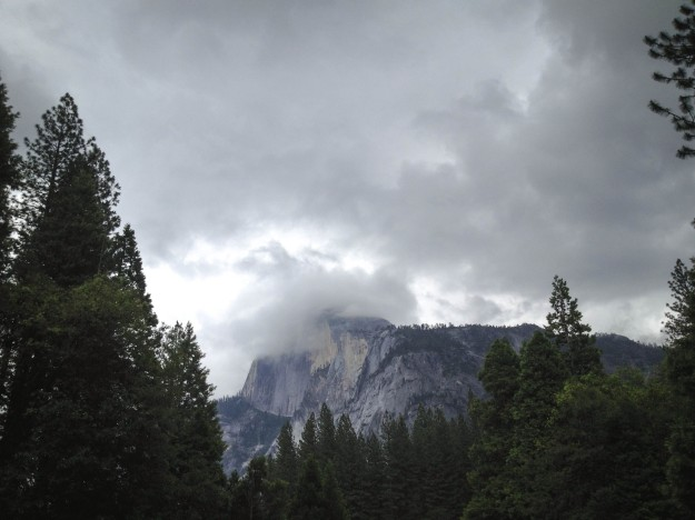 half dome covered in clouds